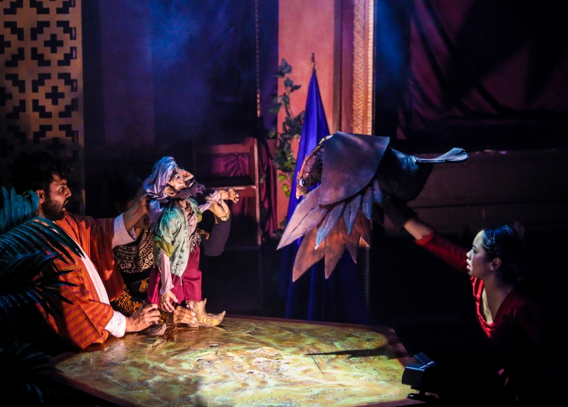 A puppet scene between Sinbad and a large bird
